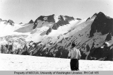 Hiker on South Cascade Glacier with view of Spire Peak,1939