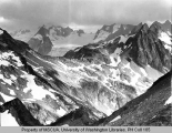 View of Dome Peak and Spire Peak in heavy clouds, 1938