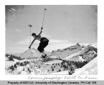 Skier making a cornice jump near Edith Creek, southeast slope of Mt. Rainier, n.d.