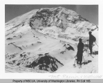 Two skiers with Mt. Rainer and Willis Wall in background, n.d.