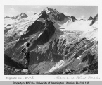 Hiker looking out on Blue Peak, Chickamin Glacier and Dome Peak, Skagit County, n.d.