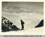 Skier viewing summit of Glacier Peak, n.d.