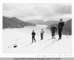 Four skiers at the Snoqualmie Pass near Lake Keechelus, n.d.