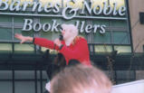 Rally with public speaker, Barnes & Noble in background, downtown Seattle