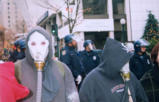 Protesters in gas masks and cops in riot gear, downtown Seattle