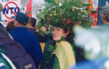 Protester wearing plant costume in a crowd