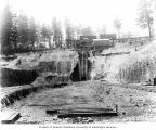 Construction of forebay leading into penstock tunnels, May 30, 1911