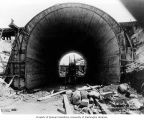 Concrete culvert for flume being built under railroad trestle at Buckley, June 10, 1911