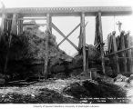 Preparing to build concrete culvert to lead flume under the railroad trestle at Buckley, April 4,...