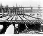 Reservoir site showing wood stave pipe and forebay construction, November 17, 1903