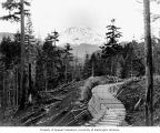Flume construction showing Mount Rainier in background, December 30, 1903