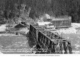 Gorge Dam Powerhouse, West Portal of tunnel, and bridge, as seen from across the Skagit River,...