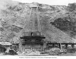 Incline railway at Reflector Bar, with workers and Great Northern Railway freight car, March 24,...