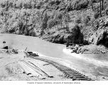 Flood water submerging diversion dam, Diablo Dam, May 20, 1928
