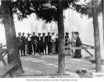 Charles Baker (man near center with hat) and guests at the Snoqualmie Falls observation platform,...