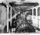 Interior of the underground chamber showing power plant water wheels and generators, n.d.