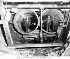 Men at north end of penstocks that connect to the powerhouse, June 13, 1925
