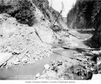 Dam construction after Baker River was blocked off by upper cofferdam, August 28, 1924
