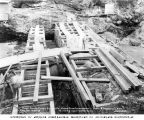 Building cofferdam in preparation for building Lower Baker River Dam, August 28, 1924