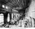 Powerhouse interior showing placement of water wheel for generating unit no. 3 using 50-ton crane,...