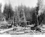 Men working on pile drivers, May 30, 1903