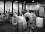 Southwest view of Newhalem powerhouse interior, showing two Pelton water wheels, generator, and...