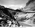 Truck crossing suspension bridge at Ruby Dam during initial construction, 1938