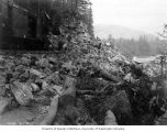 Steam shovel at rocky curve overlooking the Skagit River, used for building the railroad between...