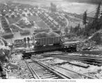 Workers taking a car load of gravel up the incline railway to the Diablo Dam site with Reflector...