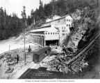 Partially completed powerhouse and penstocks, with view of railroad and cable line, June 26, 1904