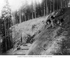 Construction on flume line at site of a landslide, August 4, 1903