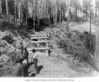 Flume line trestle construction, June 9, 1903