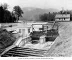 Intake gates at the diversion dam headworks and gatekeeper's house, April 12, 1912