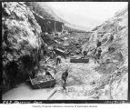 Workers removing rocks and debris from construction site , Masonry Dam, October 17, 1912