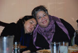 Martha Gonzalez rests on Chola Con Cello's shoulder, Women Who Rock 2011 conference, Mesob...