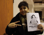 Mako Fitts with conference program, Women Who Rock 2011 conference, Seattle University Pigott...