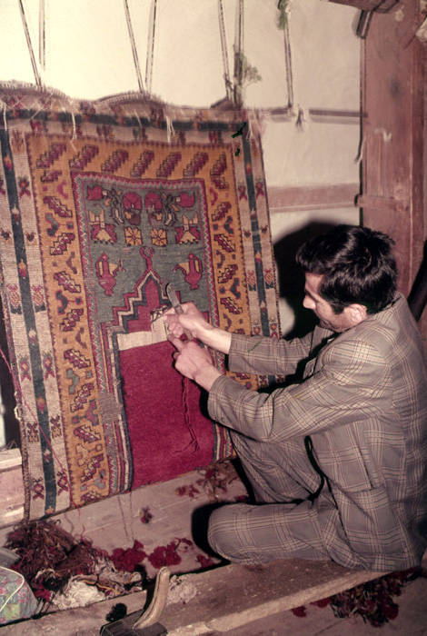 Man Weaving A Pile Weave Prayer Rug On Vertical Frame Loom