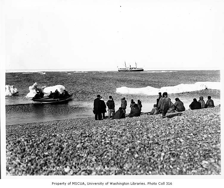 Yupik people on beach at Whalen, Siberia, with Steamship