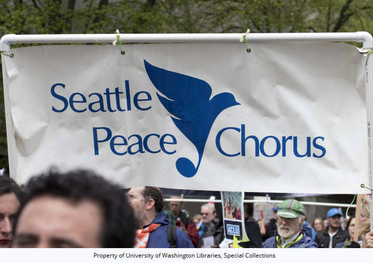 18th Annual May Day March For Workers And Immigrant Rights Blue And White Banner For Seattle Peace Chorus Madison St At 7th Ave Seattle Washington May 1 2017 Pacific Northwest Political