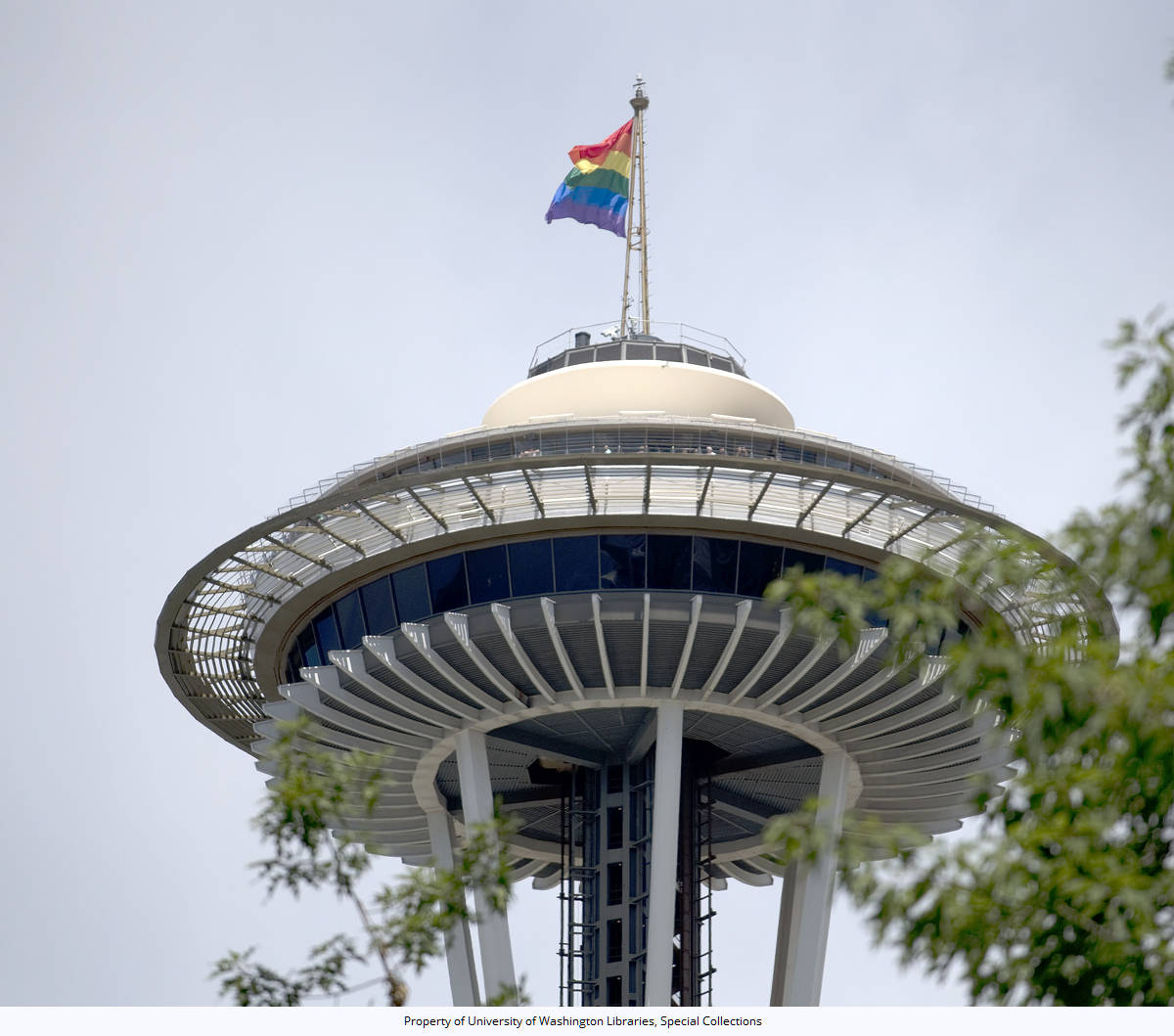 43rd Annual Pride Parade: Rainbow flag flies from the top of the Space Needle, 4th Ave. and Battery St., Seattle, Washington, June 25, 2017